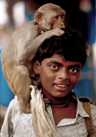 Southern Indian Boy with monkey/Hoechst Pharmaceutical